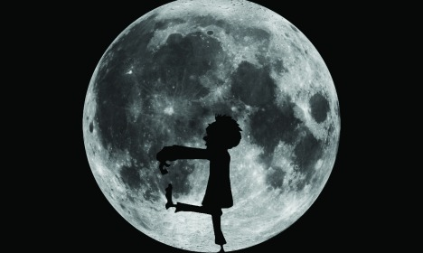 Zombie sleepwalker in front of moon