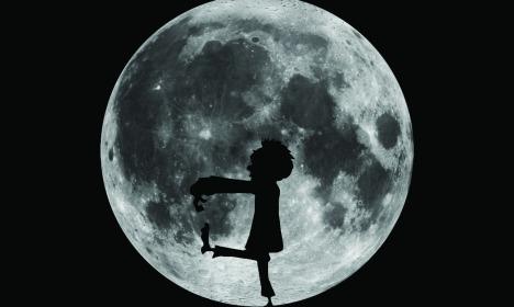 Zombie sleepwalker in front of moon