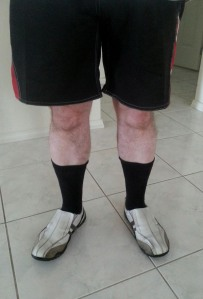 Man wearing black business sock white shoes and shorts