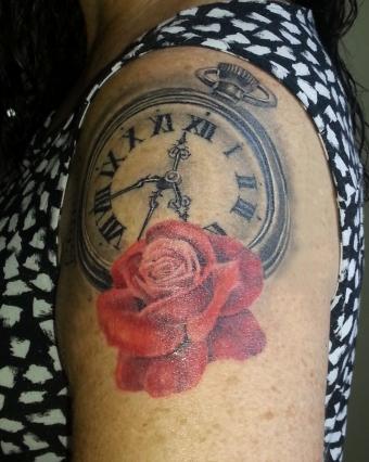 beautiful tattoo of rose and clock